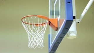 Practicing shoot at basketball hoop indoors