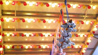 Prizes hanging at carnival game with flashing lights 4k
