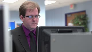 Professionally dressed male on computer