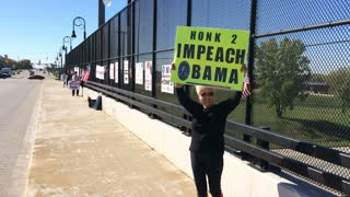Protestors with Impeach Obama signs