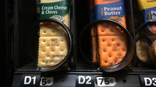 Purchasing Peanut Butter crackers from vending machine