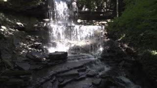 Quiet and secluded waterfall in forest 4k
