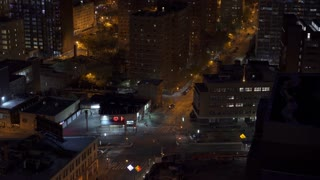 Quiet city streets of Brooklyn New York at night seen from above 4k