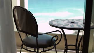 Quiet hotel balcony with beautiful view tilt.