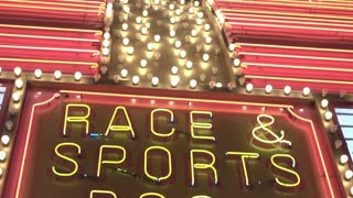 Race and sports book light flashing at casino exterior 4k