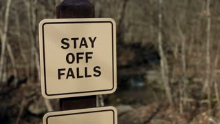 Rack focus of stay off falls sign