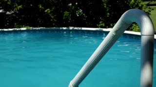 Rail going into Swimming pool on summer day