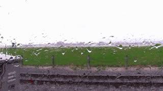 Rain drops on train window stationary