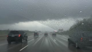 Rainy and stormy day driving down highway in car