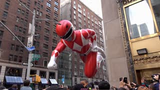 Red Power Ranger flying through buildings of New York City 4k