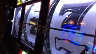 Reels of slot machine spinning at casino