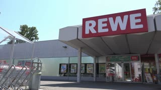 Rewe Grocery store entrance in Germany 4k