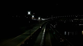 Riding train at night with lights on track