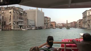 Riding water taxi in Venice Italy