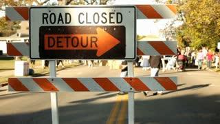 Road closed detour sign at Street Fair