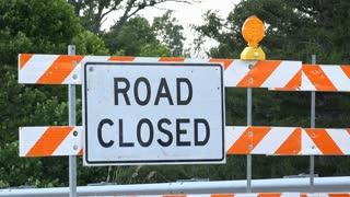 Road closed sign blockading street 4k