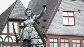 Roemer in downtown Frankfurt Germany with Statue Of Justice 4k