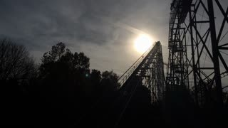 Rollercoaster silhouette going down hill
