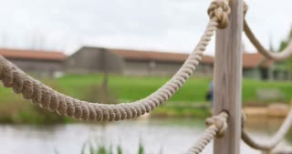 Rope railing and post by pond 4k