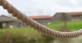 Rope railing near pond pan shot 4k