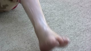 Rubbing Lotion into leg and foot