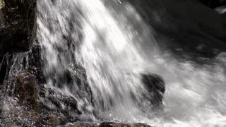 Rushing water smashing down onto rock floor 4k