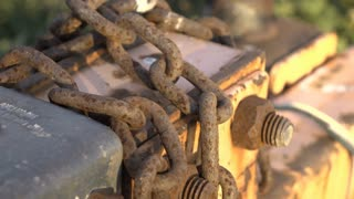 Rusting chain on farm equipment detail shot 4k