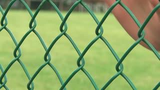Sad Hand Motion on fence
