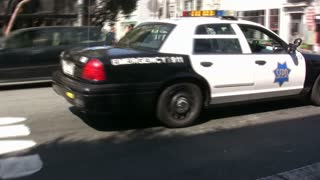 San Fransisco Police Car Driving down Street