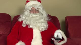 Santa Claus channel surfing on couch pan