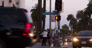 Santa Monica Blvd intersection and sidewalk at sunset 4k