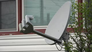 Satellite dish television provider in front of house 4k
