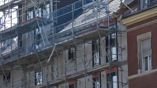 Scaffolding on side of building under construction 4k