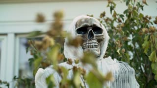 Scary skull Halloween decoration outside of home 4k