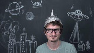 Screaming nerd with alien chalkboard background