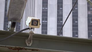 Security camera watching people in city 4k