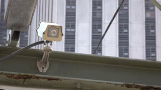 Security camera with office building in background 4k
