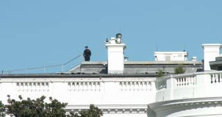 Security guard standing on roof of White House 4k