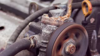 Serpentine belt on car engine rotating in slow motion