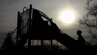 Shadows of kids on playground with sun