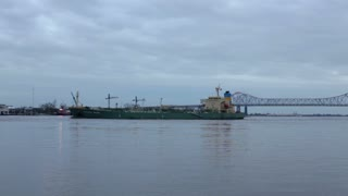 Ship leaving New Orleans port in the evening