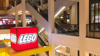 Shoppers at Mall of American and Lego store logo 4k