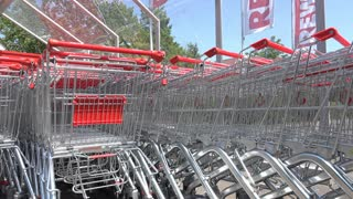 Shopping carts parked at European grocery store 4k