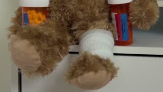 Sick bear sitting on shelf with drugs
