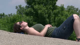 Side View of Girl laying on Hot Concrete