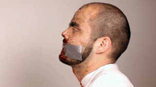 Side View of Man with Duct Tape on Mouth