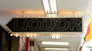 Sign for liquor flashing at store