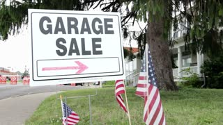 Sign pointing in direction of Garage sale