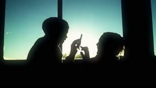 Silhouette of boy and mom