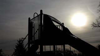 Silhouette of Kids at Playground